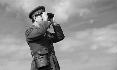 Forces soldier looking through binoculars